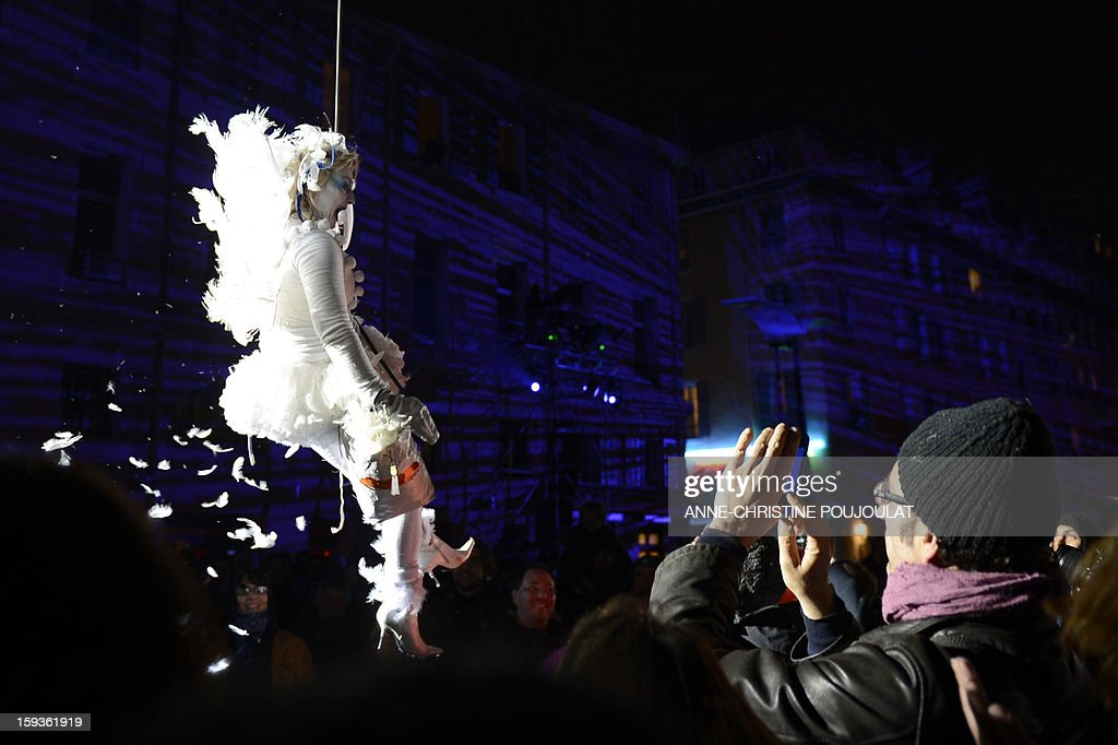 An artist from the Studio de Cirque company performs during 'Place des Anges' at the Cours d'Estienne d'Orves in Marseille on January 12, 2013, one of the events marking the launching of festivities for the Marseille-Provence 2013 European Capital of Culture. The event marks the start of a year of cultural renaissance in France's second-largest metropolitan area. AFP PHOTO / ANNE-CHRISTINE POUJOULAT