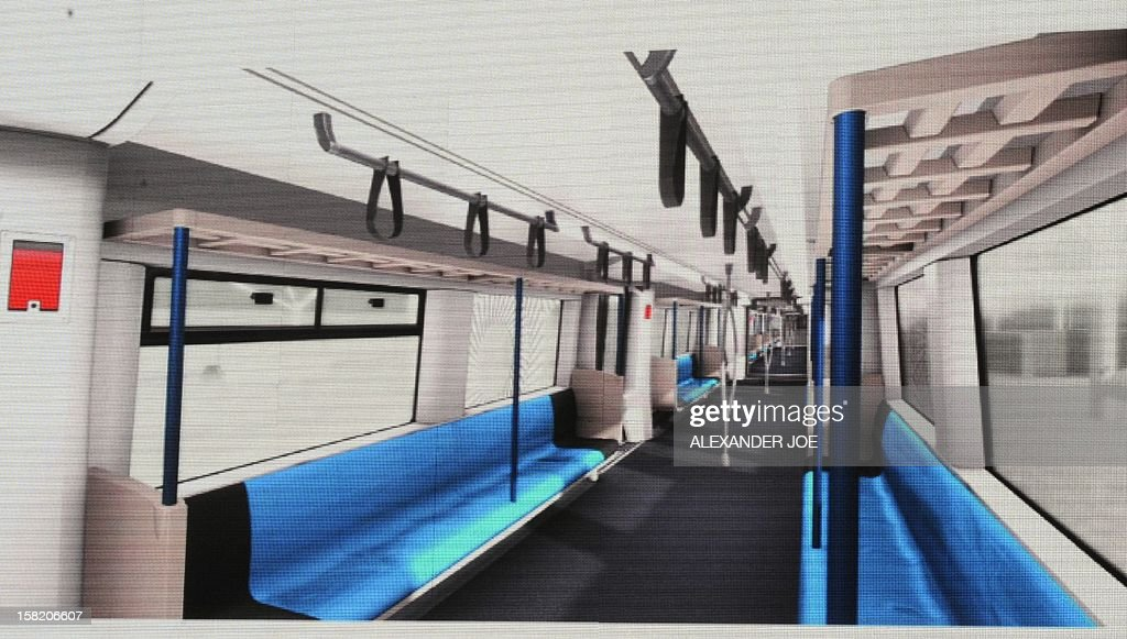 An artist impression displayed during a press conference in Johannesburg on December 11 shows a carriage of a commuter train that will start running in South Africa in 2015. The Passenger Rail Agency of South Africa (PRASA) announced on December 11 that a consortium led by French company Alstom had won a 5.8 billion US dollar tender to overhaul the PRASA network, building 600 trains and 3,600 waggons over a 10-year period from 2015 to 2025.