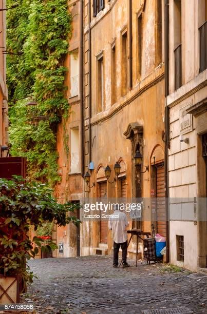 An artist is seen at Vicolo di Febo street on November 1 2017 in Rome Italy Rome is one of the most popular tourist destinations in the World