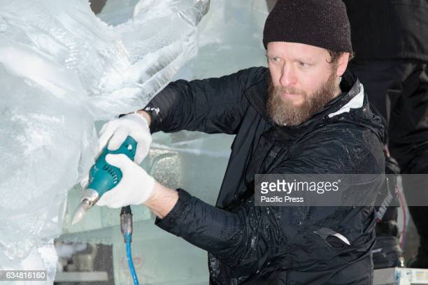 An artist making ice sculptures The Central Park Conservancy hosts this annual Valentines Day event at the Naumburg Bandshell to celebrate the love...