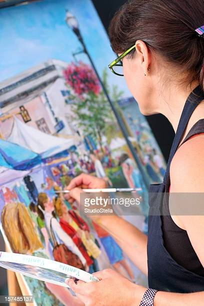 An artist painting on a canvas