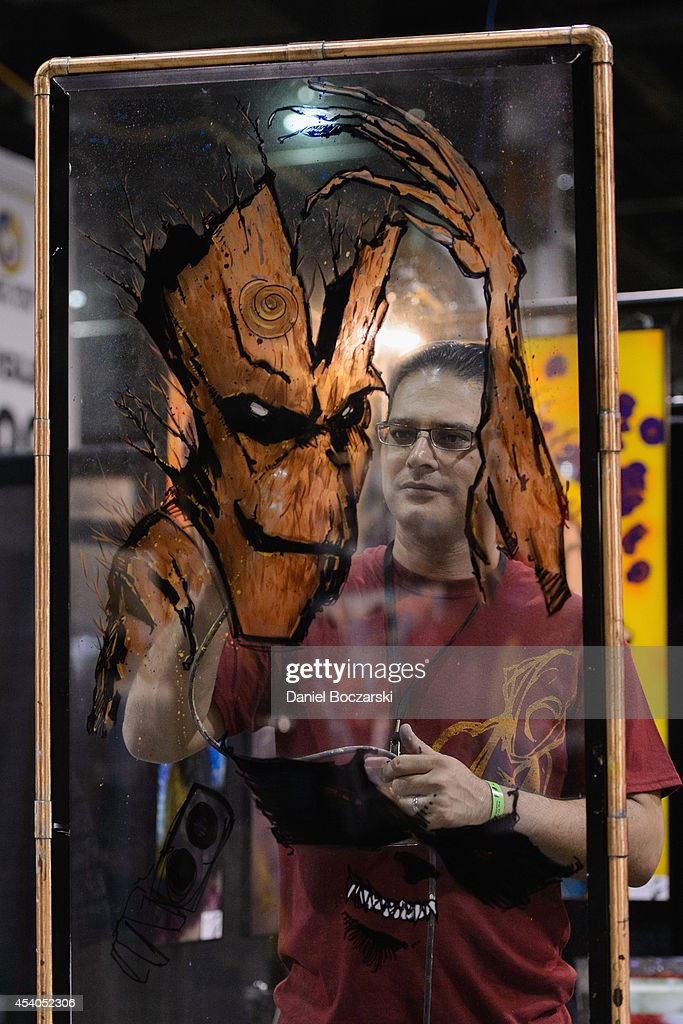 An artist paints a drawing during Wizard World Chicago Comic Con 2014 at Donald E. Stephens Convention Center on August 23, 2014 in Chicago, Illinois.