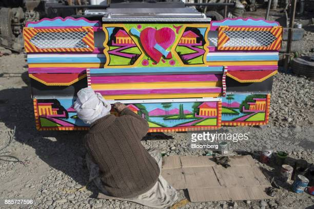 An artist paints a transfer truck at a yard in Kabul Afghanistan on Saturday Nov 4 2017 The Afghan economy is said to grow 26% in 2017 and revenue...
