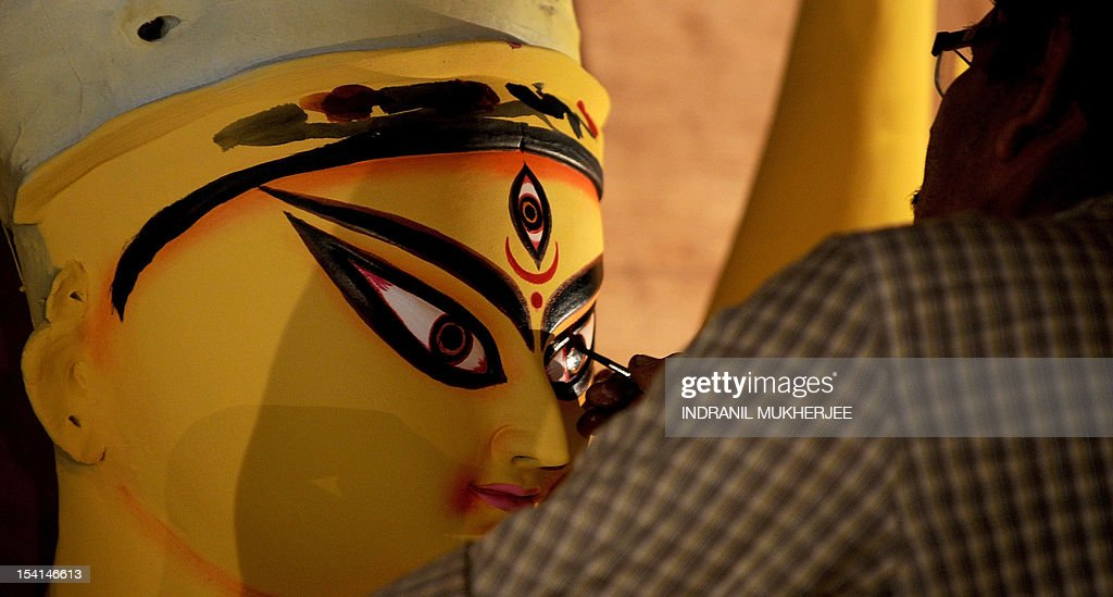 An artist paints the eyes of an idol of Hindu Godess Durga on the last day of 'Pitrupaksh' - days for offering prayers to ancestors - at a workshop in Mumbai on October 15, 2012. In Hindu mythology this day is also called 'Mahalaya' and describes the day when the gods created the ten armed goddess Durga to destroy the demon king Asura who plotted to drive out the gods from their kingdom. The five-day period of worship of Durga, who is attributed as the destroyer of evil, commences on October 20.