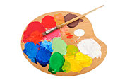 Paint brush on the palette with bright acrylic color