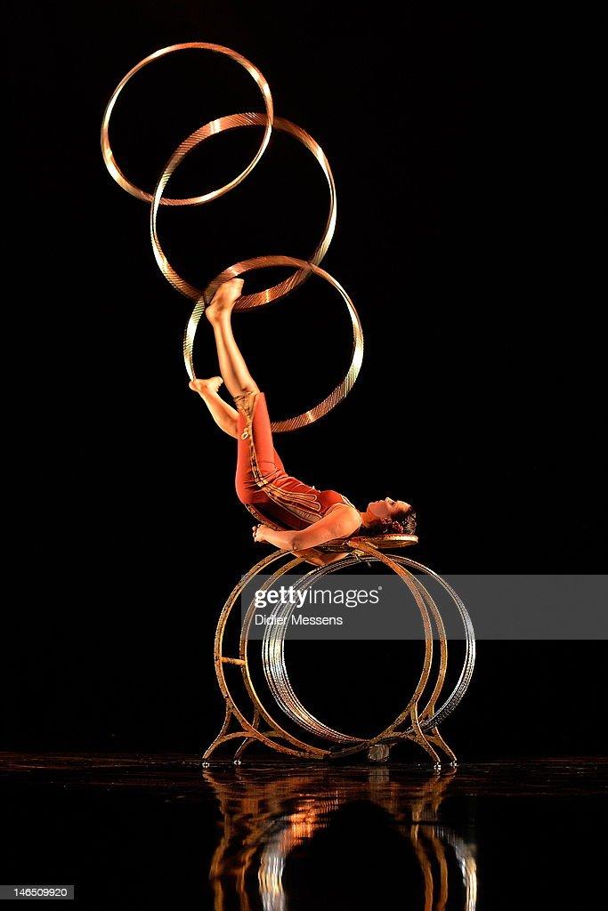 An artist performing a hoop act during the Belgian premiere of the Cirque du Soleil show Corteo on June 13, 2012 in Antwerpen, Belgium.