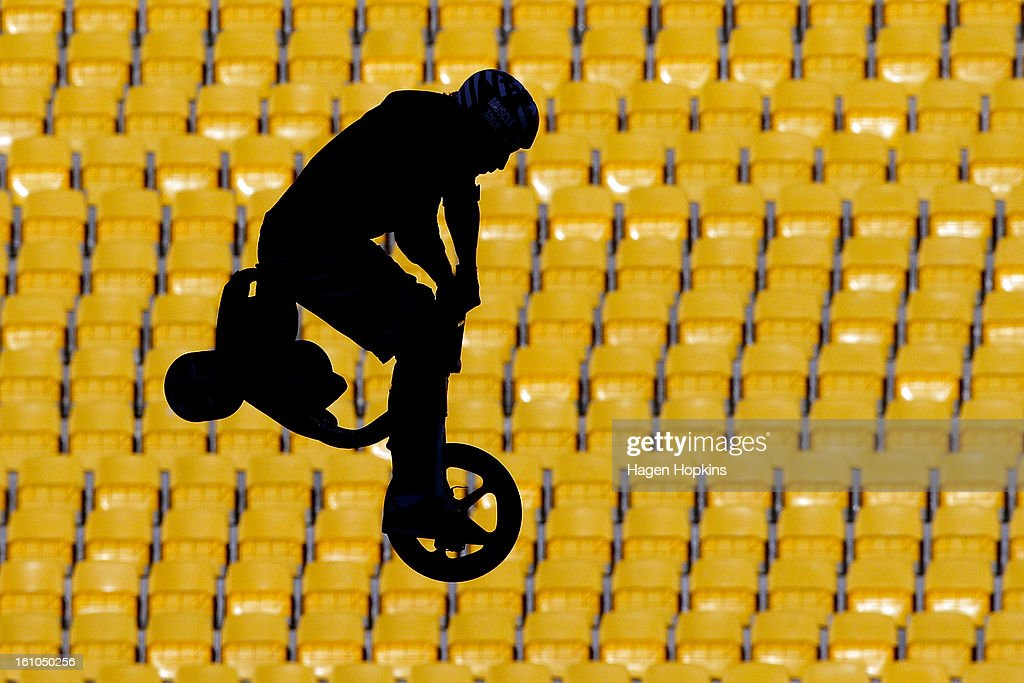 An artist performs a stunt on a tricycle during Nitro Circus Live at Westpac Stadium on February 9, 2013 in Wellington, New Zealand.