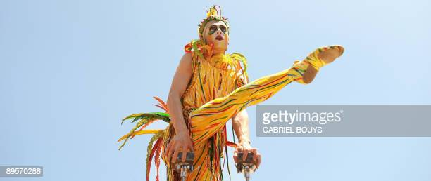 An artist performs at the Grove in Los Angeles on August 2 2009 to celebrate the 25th anniversary of the Cirque du Soleil The Cirque du Soleil is a...
