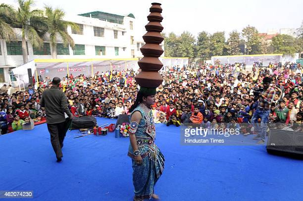 An artist performs during a Vasant Panchami festival on January 24 2015 in Noida India Vasant Panchami sometimes referred to as Saraswati Puja or...