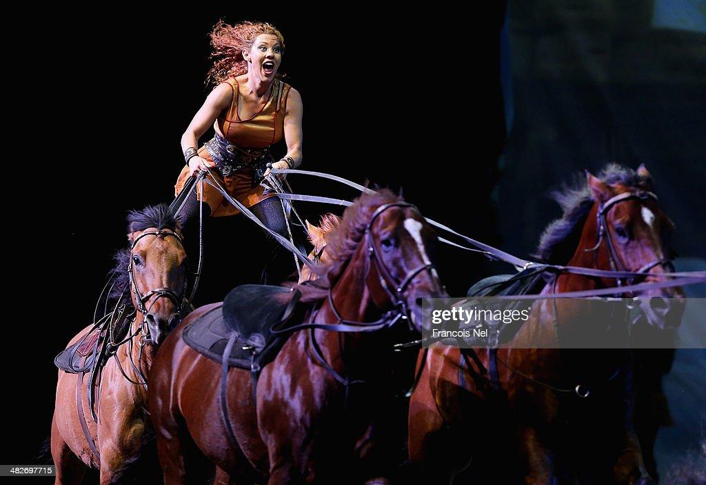 An artist performs during the equestrian extravaganza 'Cavalia' at Dubai World Trade Centre on April 3, 2014 in Dubai, United Arab Emirates.