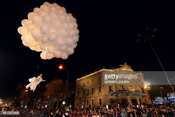An artist performs in the air with balloons at Cibeles Square during the Three Kings parade in Madrid on January 5 2015 Every year on January 5...