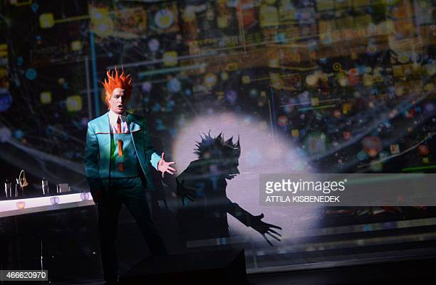 An artist performs in the Hungarian State Opera of Budapest on March 17 2015 during an opera rehearsal of Richard Wagner's 'Rheingold' directed by...