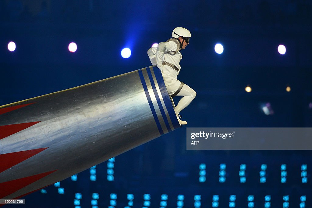An artist performs on a cannon perform during the closing ceremony of the London 2012 Olympic Games in the Olympic Stadium in east London on August...