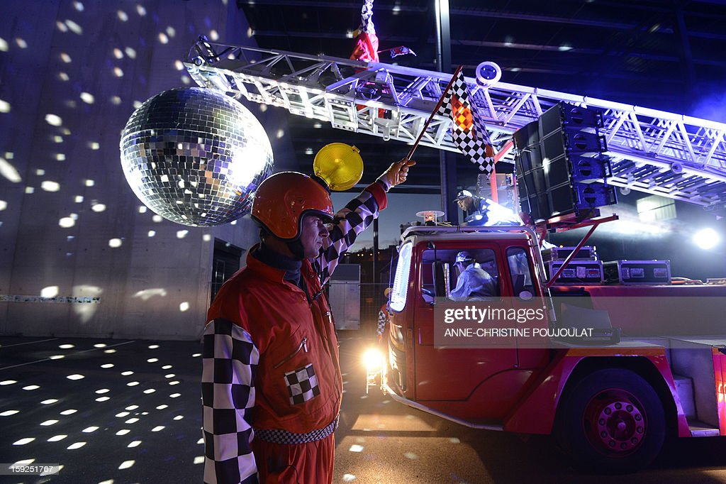 An artist performs on January 10, 2013 in Marseille southern France, during a rehearsal of the Light Parade by Sud Side Company ahead of the 2013 'Marseille-Provence European Capital of Culture' event. On January 12, the city will be named 'capital of culture' which will kick off a range of exhibitions and events.