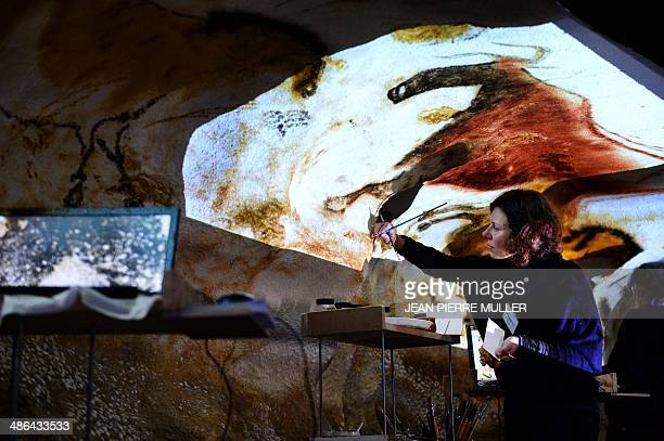 An artist redraws a Lascaux painting in a workshop on April 24 in Montignac southern France French Culture Minister Aurelie Filippetti inaugurated...