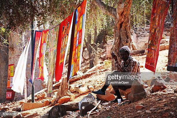 An artist sits on the Ile De Gore on December 27 2007 near Dakar Republic of Senegal The Gore island is situated off the main harbour of Dakar and...