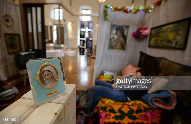 An artist sleeps on the sofa of a stand of an exhibition under the auspices of the Council of Europe called 'Have a look into my life ' in Strasbourg...