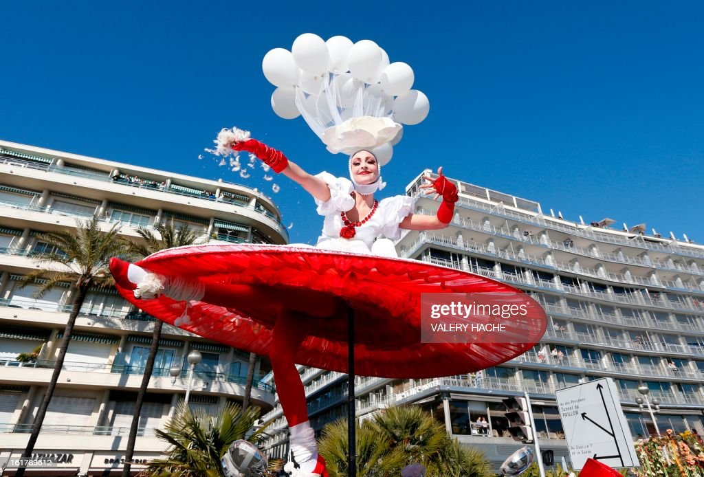 An artist takes part in the Nice Carnival parade on February 16, 2013 in Nice, southeastern France. The Carnival, starting from February 15 until March 6, 2013, will celebrate the 'King of the five continents', marking the 140th anniversary of the French Riviera Nice carnival. AFP PHOTO / VALERY HACHE