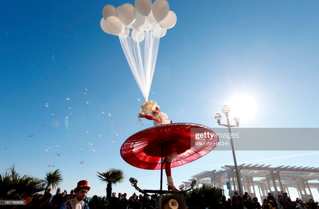 An artist takes part in the Nice Carnival parade on February 16, 2013 in Nice, southeastern France. The Carnival, starting from February 15 until March 6, 2013, will celebrate the 'King of the five continents', marking the 140th anniversary of the French Riviera Nice carnival.