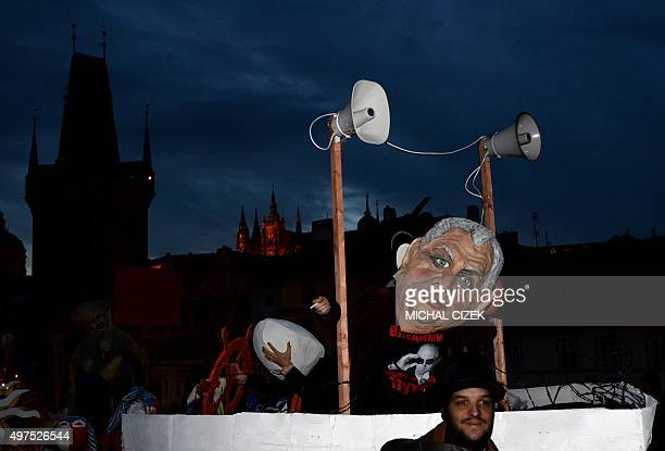 An artist wearing a mask with the face of Czech President Milos Zeman attends the carnival commemorating the 26th anniversary of the Velvet...