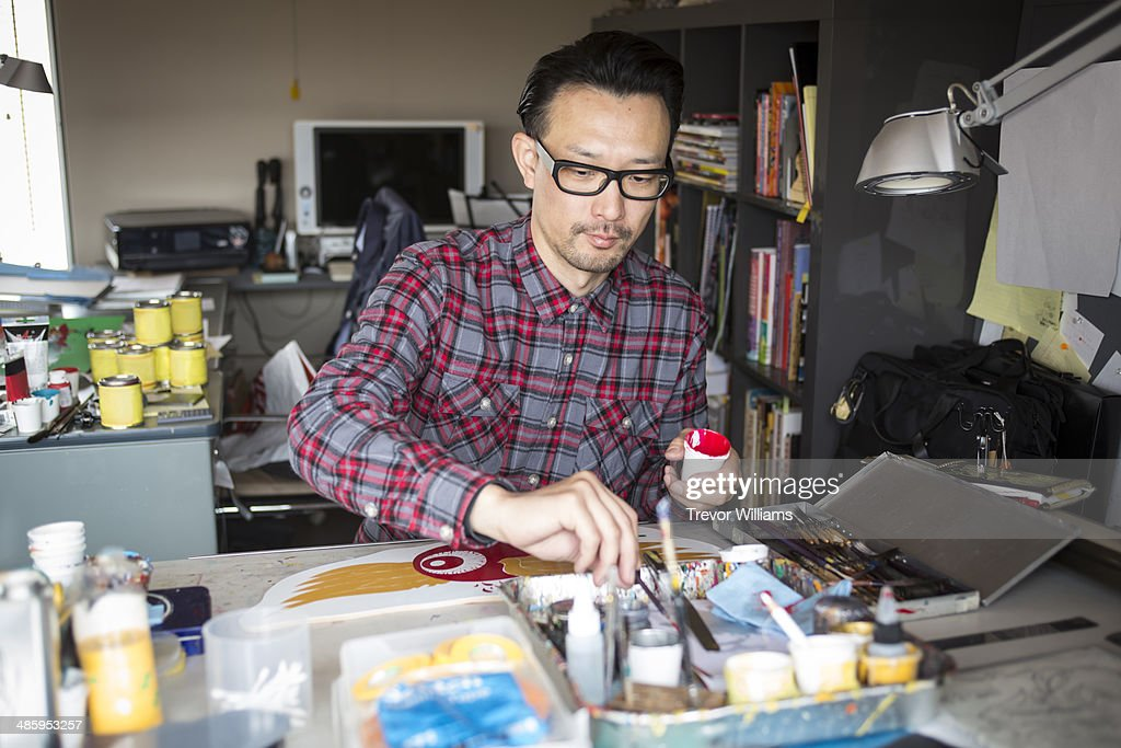An artist working on a piece using paint : Stock Photo