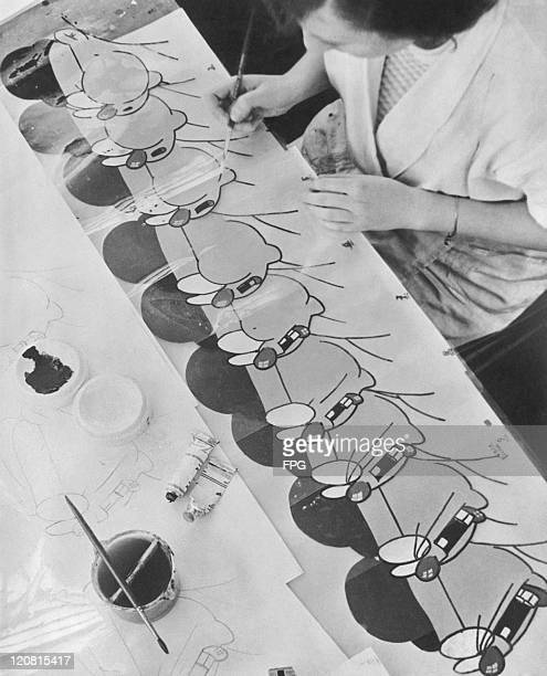 An artist working on a series of character cels for an animation being produced in a Berlin studio circa 1930
