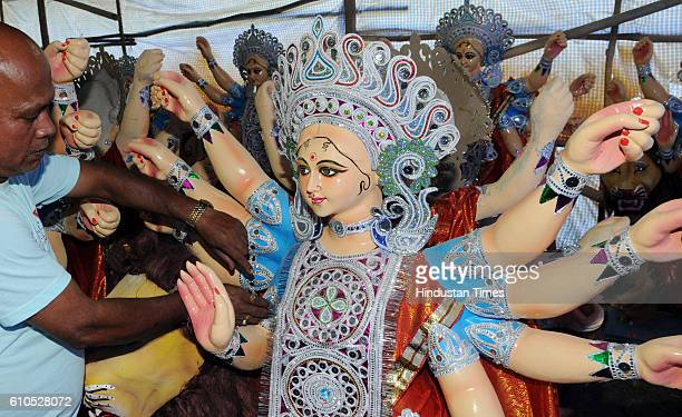 An artist working on Durga Idol for Navratri festival on September 26 2016 in Bhopal India The artists in Bhopal will be delivering idols to nearby...