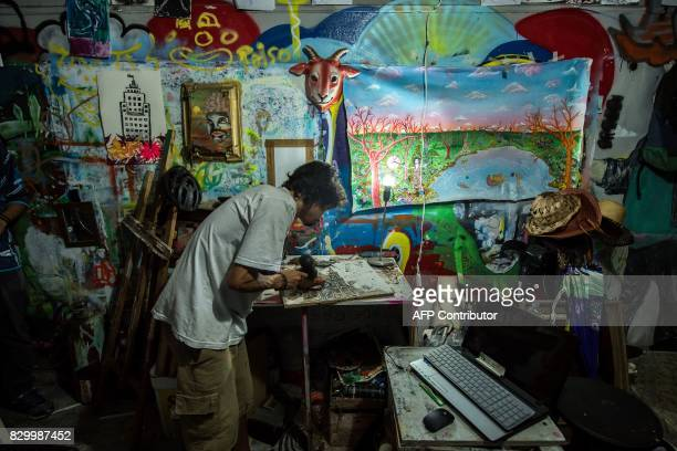 An artist works in his atelier at the 'Ocupa Ouvidor 63' building in Sao Paulo Brazil on June 28 2017 A group of about one hundred artists of...