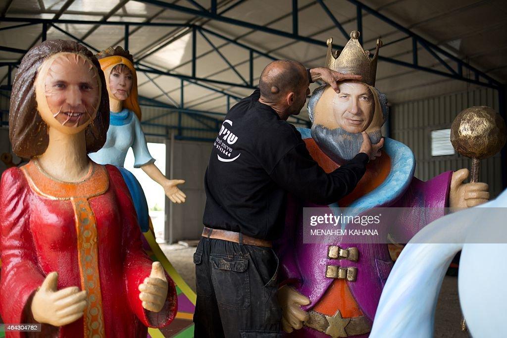 OUT== An artist works on an effigy of Israeli President Benjamin Netanyahu standing alongside effigies of Israeli MP Zahava GalOn head of the leftist...