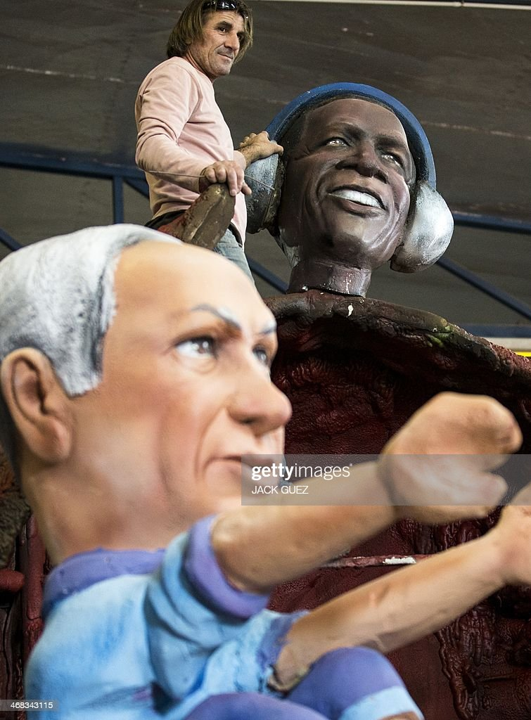 An artist works on effigies of Israeli Prime Minister Benjamin Netanyahu (L) and US President Barack Obama, during preparations for the Jewish festivities of Purim, on February 10, 2014 in the Israeli central town of Jaljulia. The carnival-like Purim holiday starts on March 16, with parades and costume parties to commemorate the deliverance of the Jewish people from a plot to exterminate them in the ancient Persian Empire 2,500 years ago, as described in the Book of Esther.
