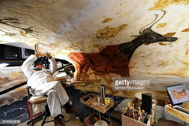 An artist works on truetolife replica of renowned Lascaux's Stone Age cave paintings on February 29 at the future international cave arts museum...