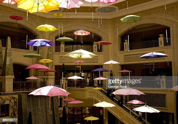 An artistic display of hanging open umbrellas in the shopping atrium of the Palazzo Hotel and Casino is seen in this 2009 Las Vegas Nevada interior...