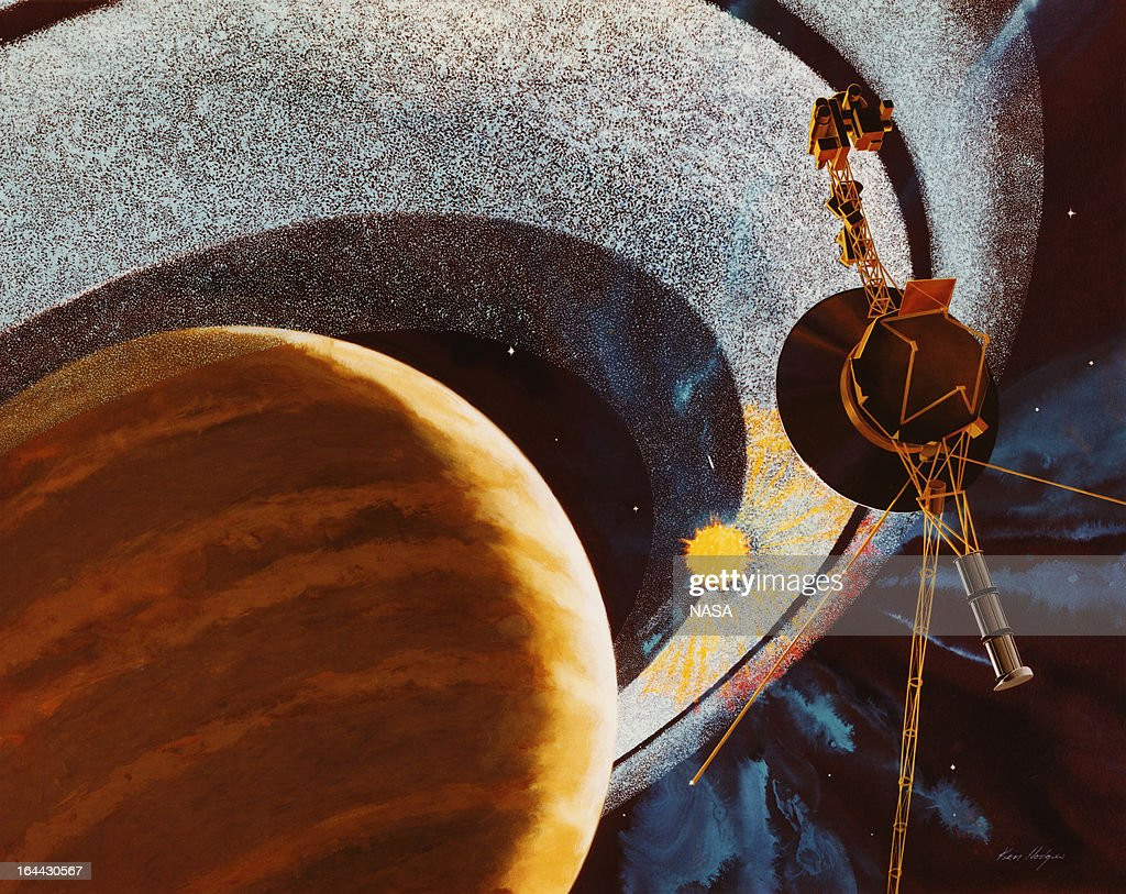 An artist's impression of NASA's Voyager 1 space probe passing behind the rings of Saturn using cameras and radio equipment to measure how sunlight...