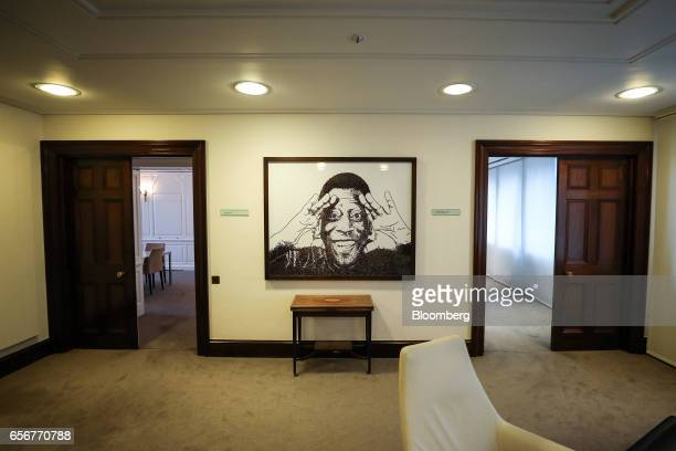 An artwork depicting the footballer Pele hangs on the wall near the boardroom at the De Beers SA headquarters on Charterhouse Street in London UK on...