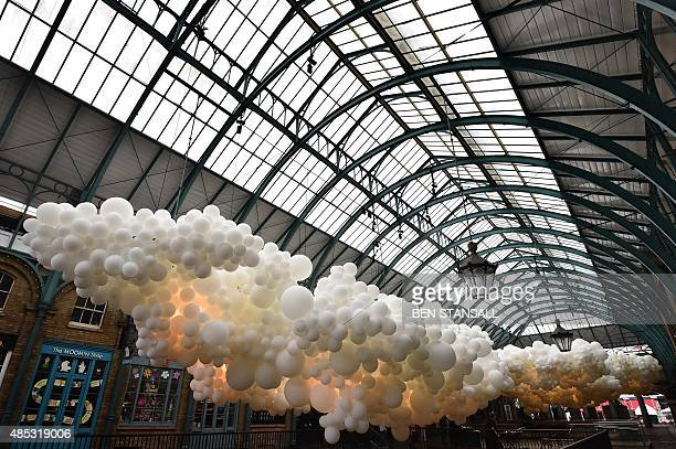 An artwork entitled 'Heartbeat' by French artist Charles Petillon is pictured during a photocall in London's Covent Garden Market building on August...