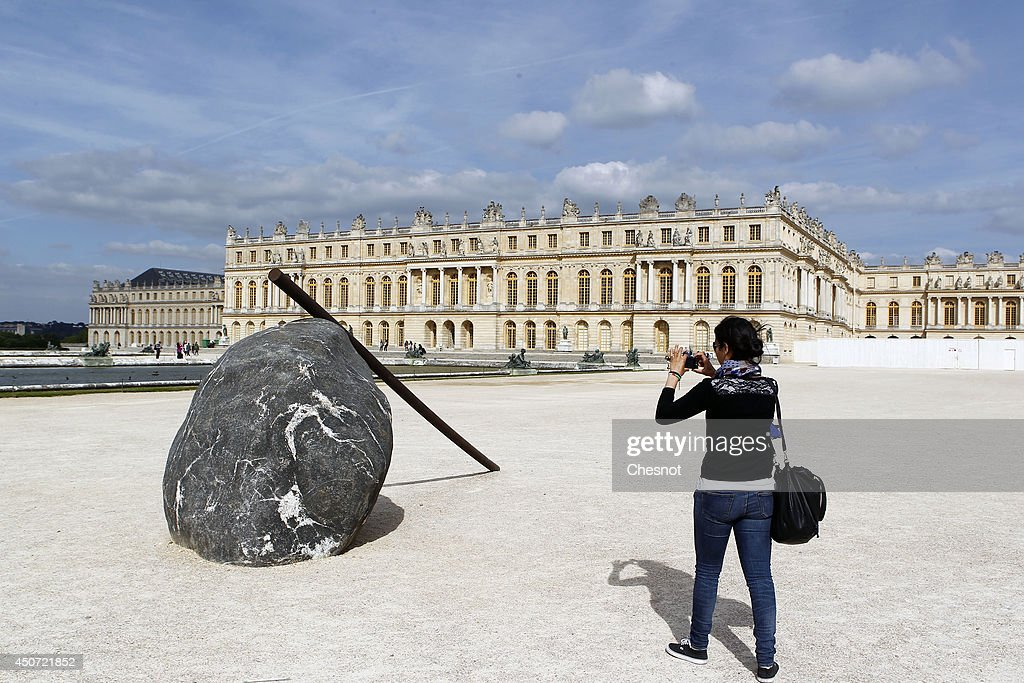 An artwork entitled 'Le baton du geant' (The cane of titan) by South Korean artist Lee Ufan is displayed during the exhibition 'Lee Ufan Versailles' at the Chateau de Versailles on June 16, 2014 in Versailles, France. Painter and sculptor Lee Ufan, 77, has created a variety of artworks made of stone and steel for an exhibition at the Chateau de Versailles, outside Paris. The exhibition opens from June 17 until November 02, 2014 at the Chateau de Versailles.