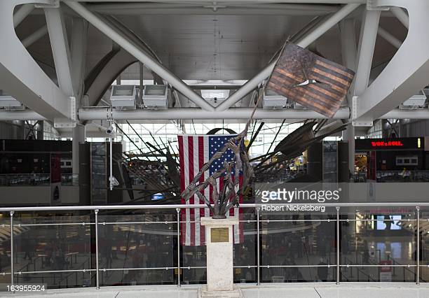 An artwork incorporating an American flag is displayed in a terminal at the John F Kennedy International Airport February 26 2013 in the Queens...