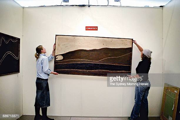 An artwork of Rover Thomas titled Lundari otherwise known as Barramundi Dreaming from the Holmes a Court Collection being hung at Christie's Sydney...