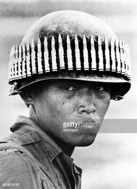 An ARVN airborne paratrooper with a band of bullets circling his helmet on Highway 13 40 miles north of Saigon April 11 1971 Chon Thanh is site of...
