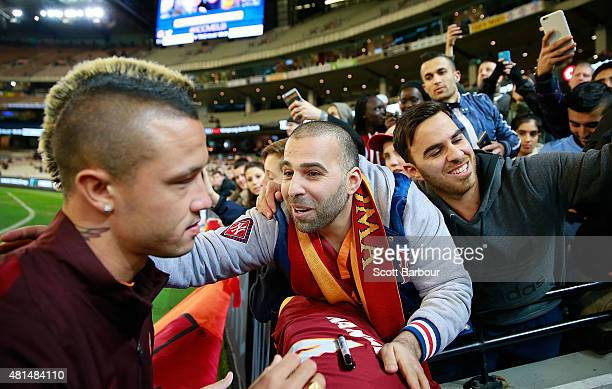 An AS Roma supporter thanks Radja Nainggolan of AS Roma after Nainggolan signed his shirt during the International Champions Cup match between...