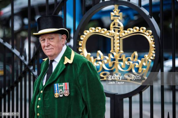 An Ascot Greencoat steward stands by the entrance gate on day 3 of Royal Ascot at Ascot Racecourse on June 22 2017 in Ascot England The fiveday Royal...