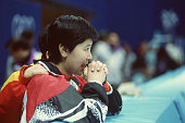 An Asian athlete watches the women's 500m final race at White Ring during the 1998 Winter Olympic games
