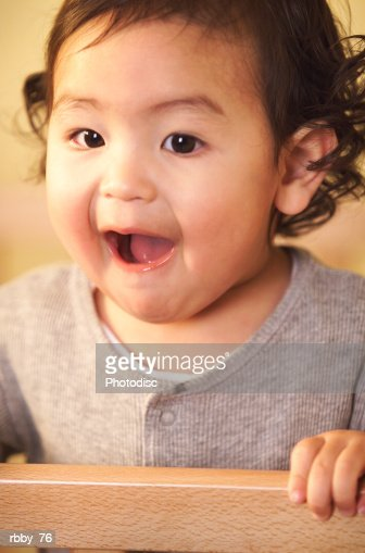 an asian baby opens its mouth in extreme surprise : Stock Photo