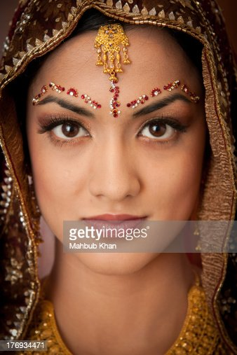 An asian bride headshot with jewellery
