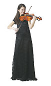 an asian female teen in a black dress stands playing her violin and smiling