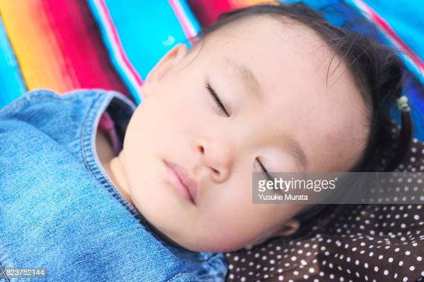 An asian little girl sleeping