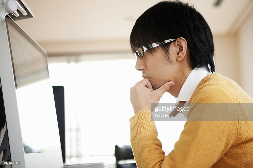 an asian man working at office : Stock Photo