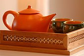 An Asian orange tranquil tea pot for two.
