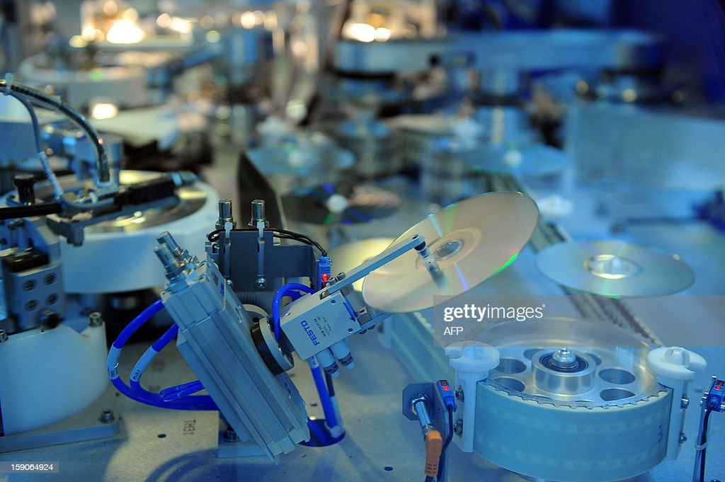 An assembly line of DVD at the MPO International company is pictured in Villaines-la-Juhel, western France, on January 7, 2013.