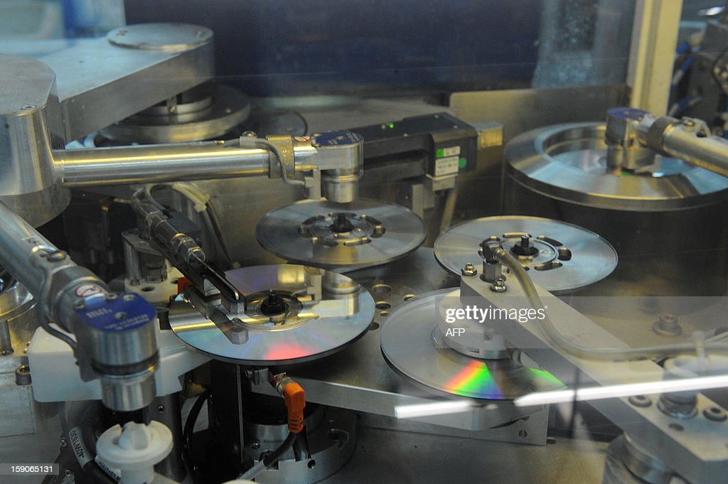An assembly line of DVD at the MPO International company is pictured in Villaines-la-Juhel, western France, on January 7, 2013. AFP PHOTO/JEAN-FRANCOIS MONIER